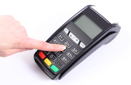 personal identification number: Hand of woman using payment terminal, enter personal identification number, credit card reader, cashless paying for shopping