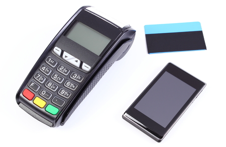 cashless: Payment terminal, credit card reader with mobile phone with NFC technology and contactless credit card, cashless paying for shopping, finance concept