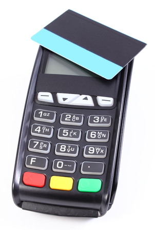 cashless: Payment terminal, credit card reader with contactless credit card on white background, cashless paying for shopping, finance concept Stock Photo