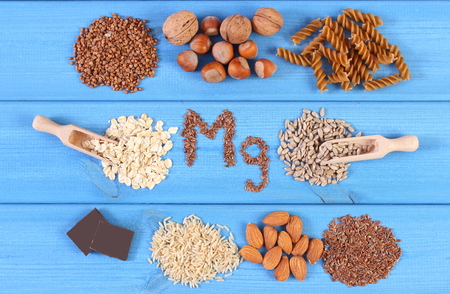 dietary fiber: Inscription Mg, ingredients and products containing magnesium and dietary fiber, healthy nutrition, wholemeal pasta, sunflower, buckwheat, oatmeal, brown rice, linseed, hazelnut, almonds, chocolate