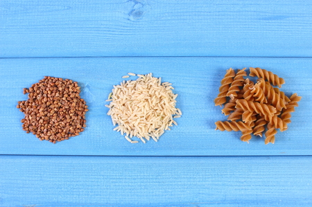dietary fiber: Wholemeal pasta, brown rice and buckwheat containing magnesium and dietary fiber, healthy food and nutrition