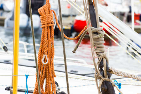 coiled rope: Yachting, coiled rope on deck of sailboat, details and part of yacht Stock Photo