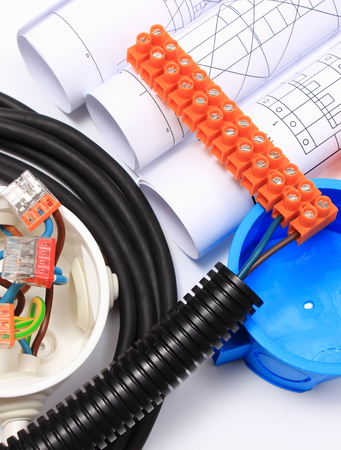 energy use: Components for use in electrical installations and rolls of electrical diagrams, copper wire connections in electrical box, energy concept Stock Photo