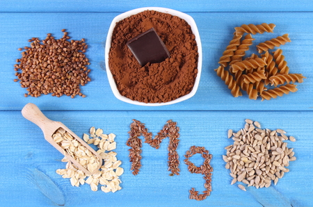 powdery: Inscription Mg, ingredients and products containing magnesium and dietary fiber, healthy nutrition, wholemeal pasta, powdery cocoa, buckwheat, oatmeal, linseed, sunflower