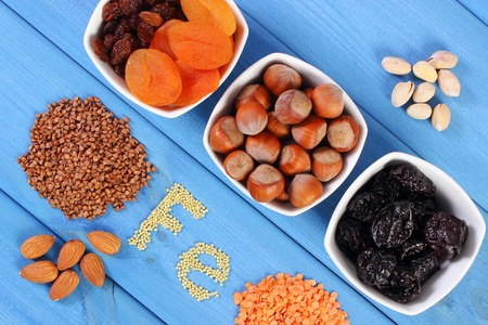ferrum: Inscription Fe, ingredients containing ferrum and dietary fiber, natural sources of iron