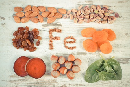 source of iron: Vintage photo, Inscription Fe, products and ingredients containing iron and dietary fiber, natural sources of ferrum, healthy lifestyle and nutrition Stock Photo