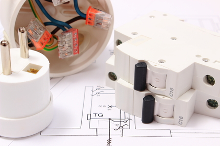 Electric fuse and plug, copper wire connections in electrical box on construction drawing of house, accessories for engineering work, energy concept