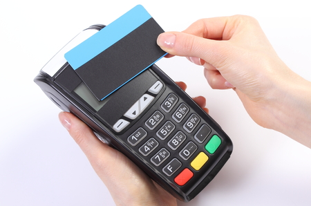 contactless: Banking and finance concept, Hand of woman using payment terminal with contactless credit card, credit card reader Stock Photo