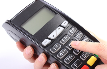 personal identification number: Banking and finance concept, Hand of woman using payment terminal, enter personal identification number, credit card reader