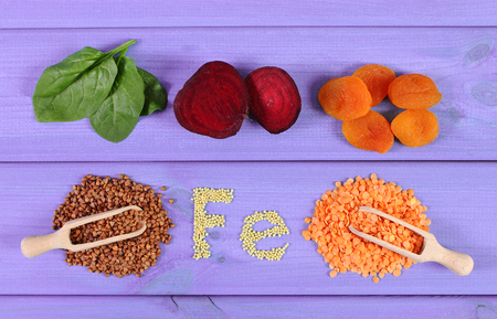 containing: Inscription Fe, ingredients and products containing iron and dietary fiber, natural sources of ferrum, healthy food and nutrition Stock Photo