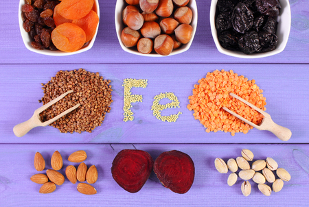 source of iron: Inscription Fe, ingredients containing ferrum and dietary fiber, natural sources of iron, healthy lifestyle, food and nutrition Stock Photo