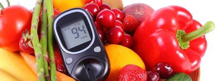 glucometer: Glucometer with fresh ripe fruits and vegetables, concept of diabetes, healthy food, nutrition and strengthening immunity Stock Photo
