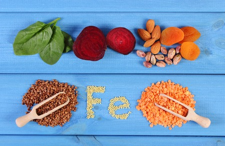 source of iron: Inscription Fe, ingredients and products containing iron and dietary fiber, natural sources of ferrum, healthy food and nutrition Stock Photo