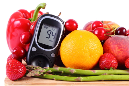 immunity: Glucose meter with fresh ripe fruits and vegetables, concept of diabetes, healthy food, nutrition and strengthening immunity