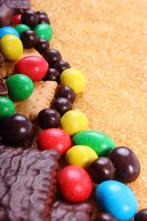 too many: A lot of candies and cookies with brown cane sugar, too many sweets, unhealthy food, reduction of eating sweets Stock Photo
