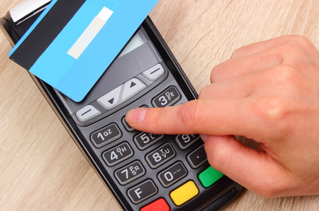 personal identification number: Hand of woman using payment terminal with contactless credit card, enter personal identification number, credit card reader, finance and banking concept