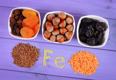 ferrum: Inscription Fe, ingredients containing ferrum and dietary fiber, natural sources of iron, healthy lifestyle and nutrition