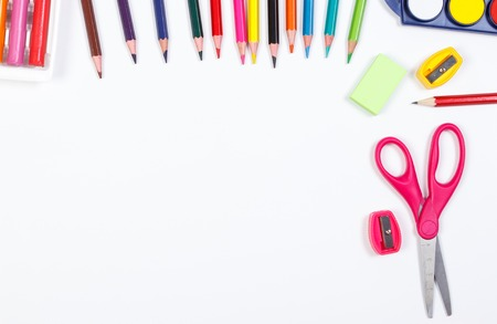 teaching crayons: School and office accessories on white background, back to school concept, copy space for text or inscription Stock Photo