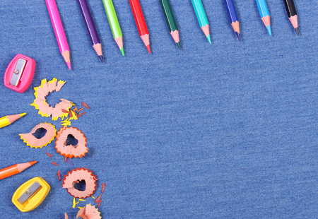 teaching crayons: Frame of school supplies on jeans background, copy space for text or inscription, back to school concept