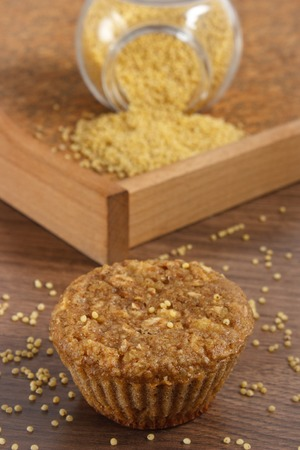 Fresh muffin with millet groats, oatmeal flakes, cinnamon and apple baked with wholemeal flour, concept of delicious, healthy dessert or snack