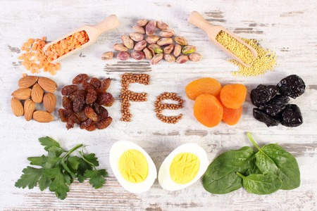 ferrum: Inscription Fe, ingredients or product containing iron and dietary fiber, natural sources of ferrum, healthy lifestyle, food and nutrition Stock Photo