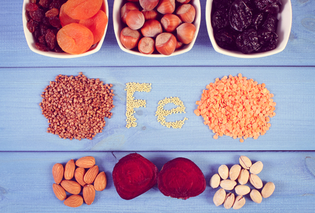 ferrum: Vintage photo, Inscription Fe, ingredients containing ferrum and dietary fiber, natural sources of iron, healthy lifestyle, food and nutrition