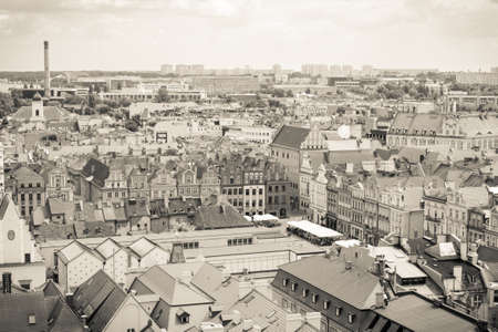 apartment tower old town: Poznan, Poland - June 28, 2016: Black and white photo, View from tower on city market, old and modern buildings in center of polish town Poznan Editorial
