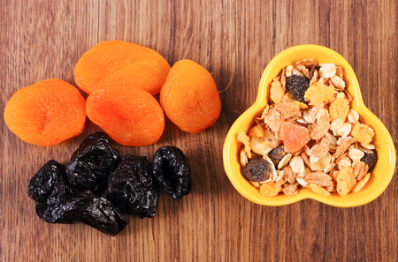 Portion of dried fruits and muesli in bowl, concept of healthy nutrition and increase metabolism, ingredients with dietary fiber Banque d'images