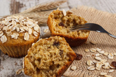 Fresh muffins with oatmeal baked with wholemeal flour and ears of rye grain, concept of delicious, healthy dessert or snack Stock Photo