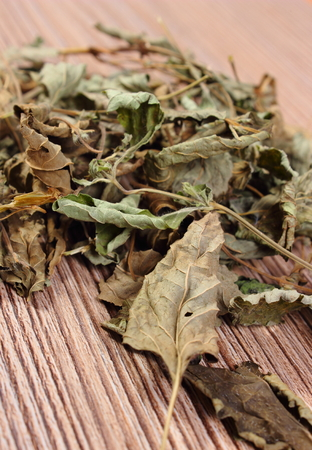 sedative: Heap of healthy dried lemon balm on wooden board, sedative herbs, concept for healthy nutrition and herbalism