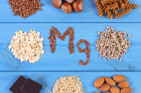 Inscription Mg, ingredients or products containing magnesium and dietary fiber, healthy nutrition Stock Photo