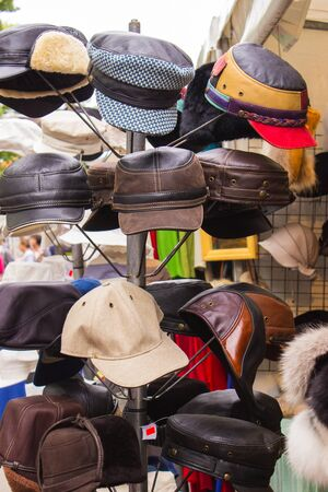 head protection: Collection of handmade hats and caps on stall at the bazaar, head protection