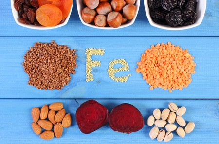 ferrum: Inscription Fe, ingredients containing ferrum and dietary fiber, natural sources of iron, healthy lifestyle, food and nutrition Stock Photo