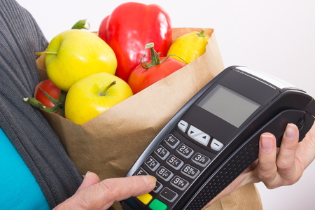 personal identification number: Hand of elderly senior woman using payment terminal, enter personal identification number, healthy nutrition