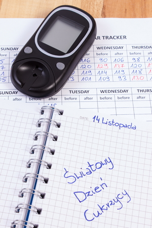 medical fight: Polish inscription world diabetes day written in notebook, medical forms with results of measurement of sugar and glucose meter, symbol of diabetic and fight against diabetes