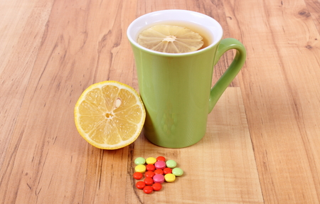 runny: Medical pills and hot tea with lemon, treatment of colds, flu and runny