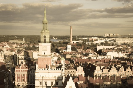 wielkopolskie: Poznan, Poland - August 30, 2016: Aged photo, View at sunset from tower on town hall, old and modern buildings in center of polish city Poznan, Greater Poland province