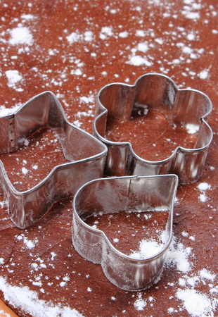 pastry cutters: Cookie cutters lying on dough for cookies, concept of baking Stock Photo