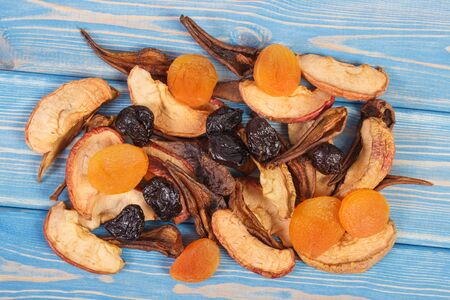 Dried ingredients for preparing beverage or compote of dried fruits lying on wooden boards, healthy nutrition