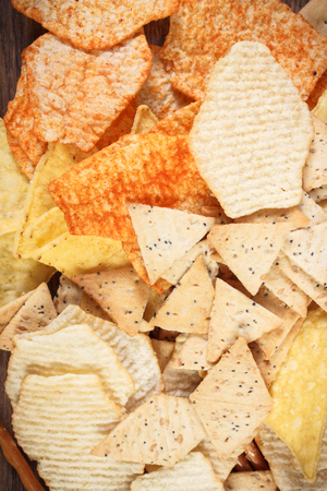 gressins: Heap of crunchy potato crisps, breadsticks and cookies, concept of restriction eating unhealthy and salted food
