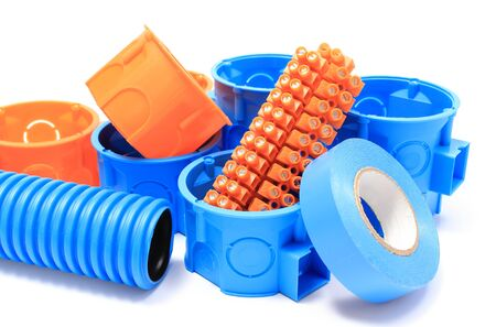 Orange and blue electrical boxes with components for use in electrical installations, accessories for engineering jobs