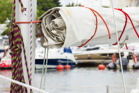 coiled rope: Yachting, parts of sailboat in port of sailing, coiled rope, sail, details of yacht Stock Photo