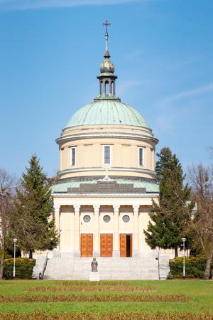 wielkopolskie: Poznan, Poland - April 1, 2017: View on church of St. John Vianney on blue sky background in polish city Poznan in Solacki park