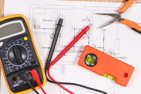 Electrical construction blueprint or diagrams, multimeter for measurement in electrical installation and accessories for engineer jobs Stock Photo