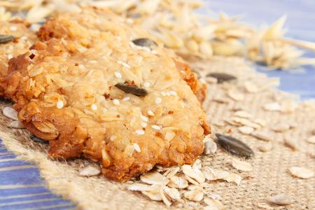 Fresh baked homemade crusty oatmeal cookies on jute burlap