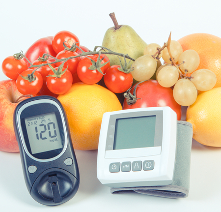 glucometer: Vintage photo, Glucometer, blood pressure monitor and fresh fruits with vegetables, concept of healthy lifestyle, diabetes and prevention of hypertension Stock Photo