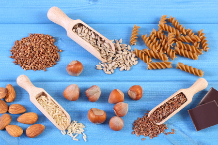 containing: Natural ingredients and products containing magnesium, dietary fiber and minerals, healthy food and nutrition concept Stock Photo