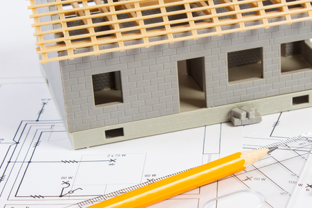 Small house under construction and accessories for drawing on electrical diagrams for project Stock Photo