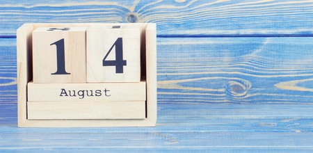 Vintage photo, August 14th. Date of 14 August on wooden cube calendar, copy space for text on board Stock Photo