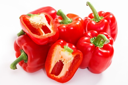 Red ripe peppers lying on white background, concept of healthy nutrition Stock Photo
